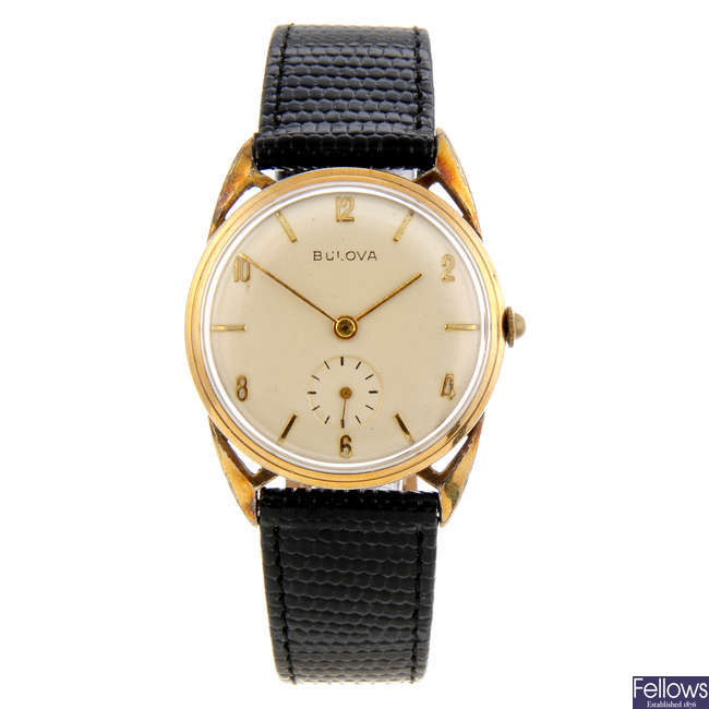 BULOVA - a gentleman's gold plated wrist watch with two Bulova watches.