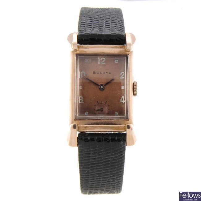 BULOVA - a rose metal wrist watch with a Bulova watch head.