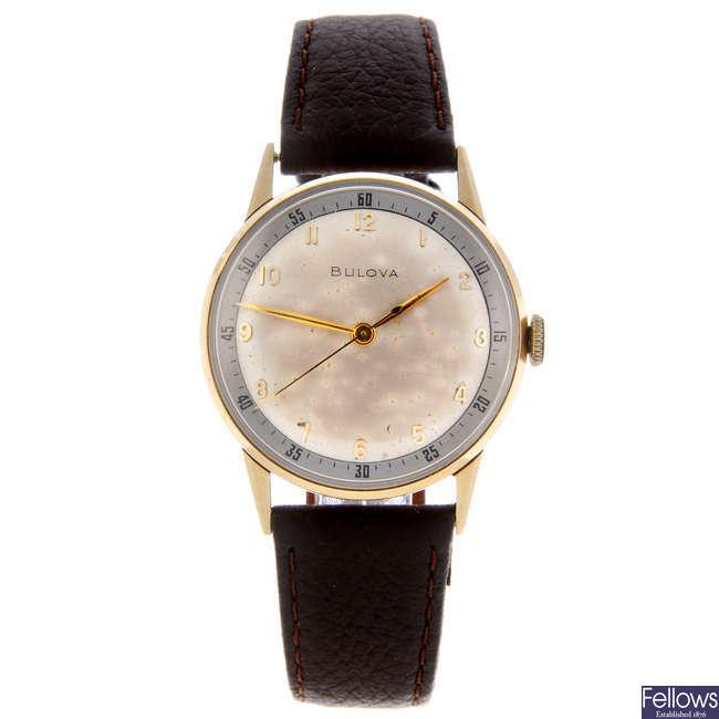 BULOVA - a gentleman's yellow metal wrist watch.