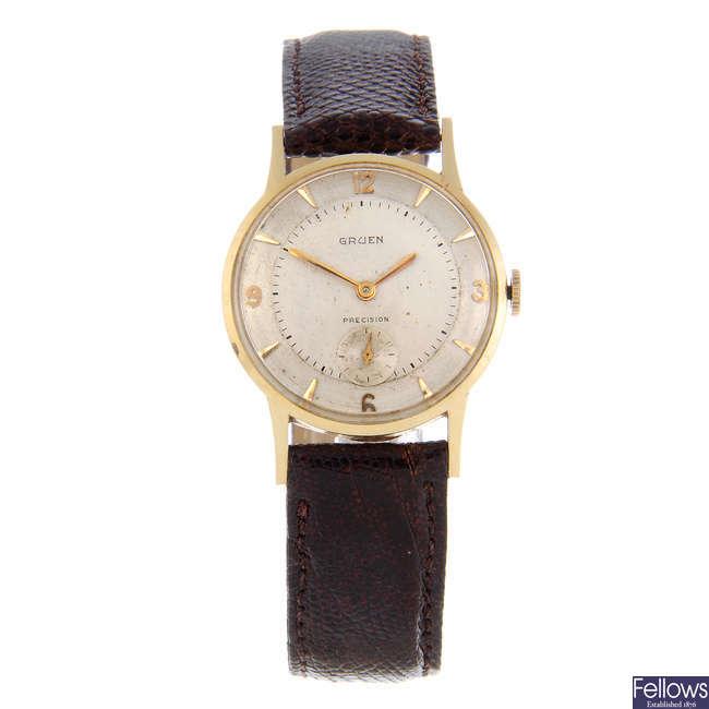 GRUEN - a mid-size yellow metal wrist watch together with another Gruen wrist watch.