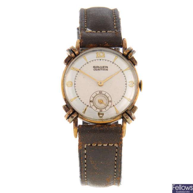 GRUEN - a mid-size gold plated wrist watch with a Gruen wrist watch.