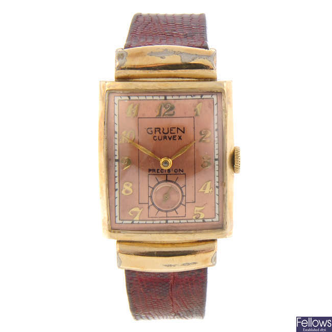 GRUEN - a gold filled Curvex wrist watch with two Gruen watch heads.
