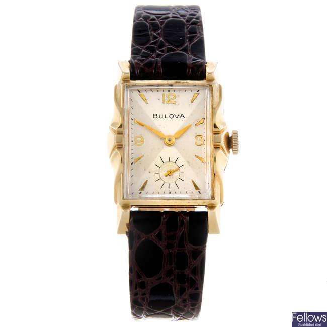 BULOVA - a yellow metal wrist watch.