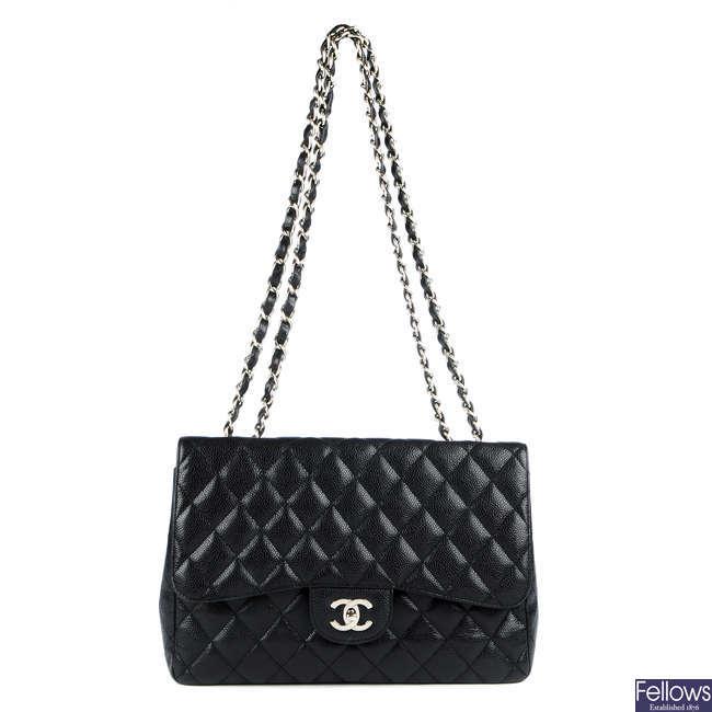 CHANEL - a Jumbo Caviar Classic Flap handbag.