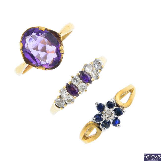 Five gem-set rings.