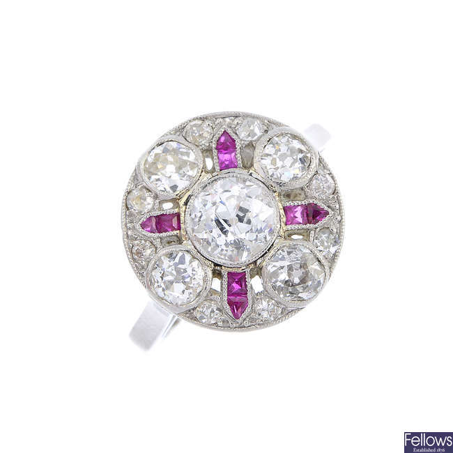 An early 20th century platinum diamond and ruby dress ring.