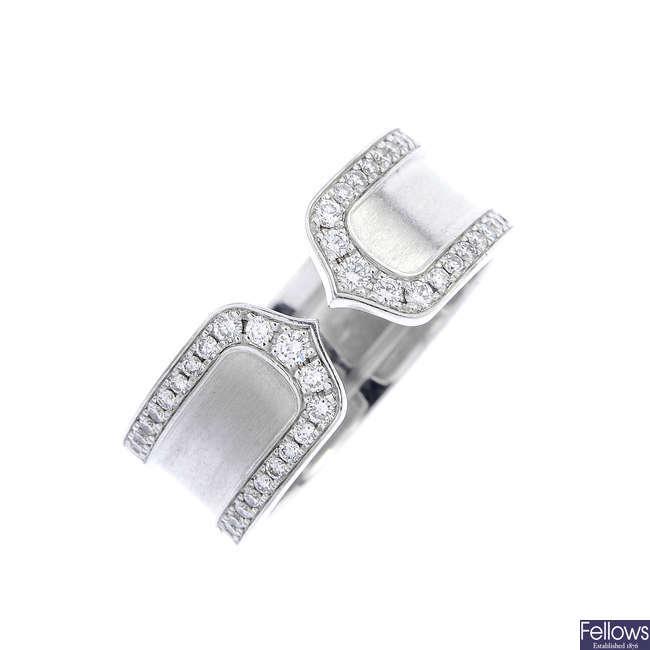 CARTIER - an 18ct gold 'C de Cartier' ring.
