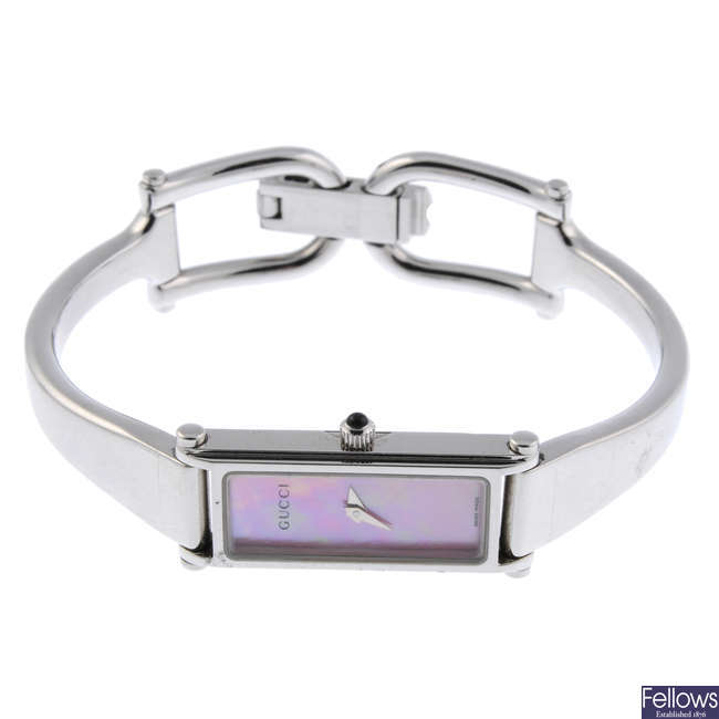 GUCCI - a lady's stainless steel 1500L bracelet watch with two Gucci watches.