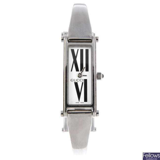 GUCCI - a lady's stainless steel 1500L bracelet watch with another Gucci bracelet watch.