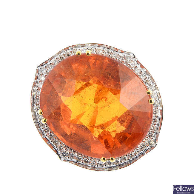 An 18ct gold hessonite garnet and diamond dress ring.
