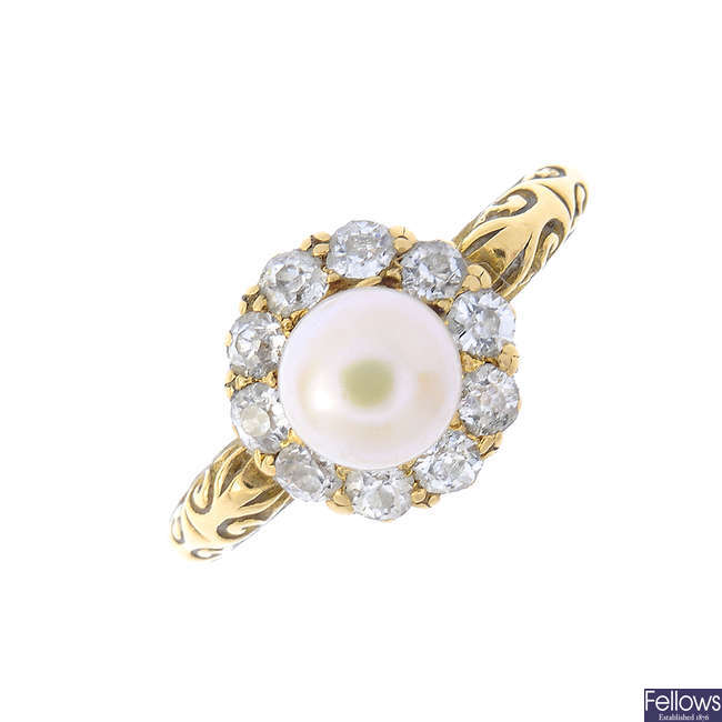 An Edwardian diamond and cultured pearl cluster ring.
