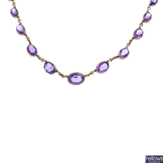 A late Victorian gold amethyst necklace.
