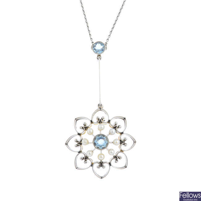 An Edwardian 15ct gold and platinum, aquamarine and seed pearl pendant, with chain.