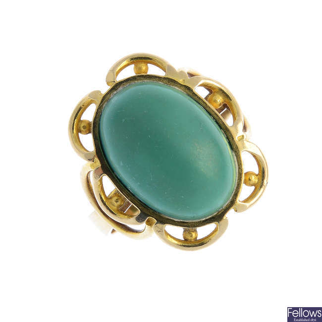 A reconstituted turquoise single-stone ring