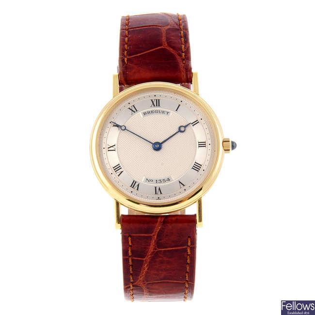 BREGUET - a mid-size 18ct yellow gold Classique wrist watch.