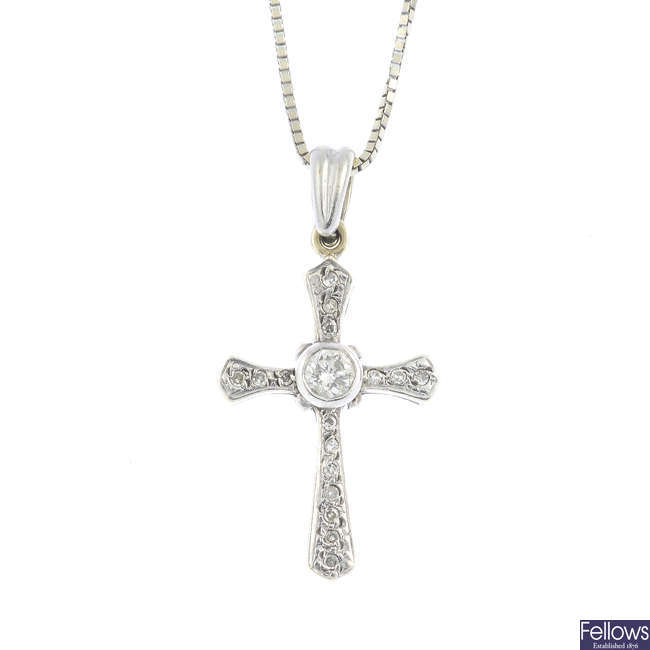A 9ct gold diamond cross pendant, with a 9ct gold chain.