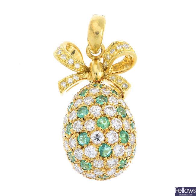 A diamond and emerald egg pendant.