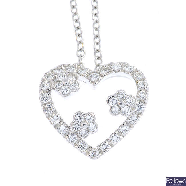 A diamond heart necklace.