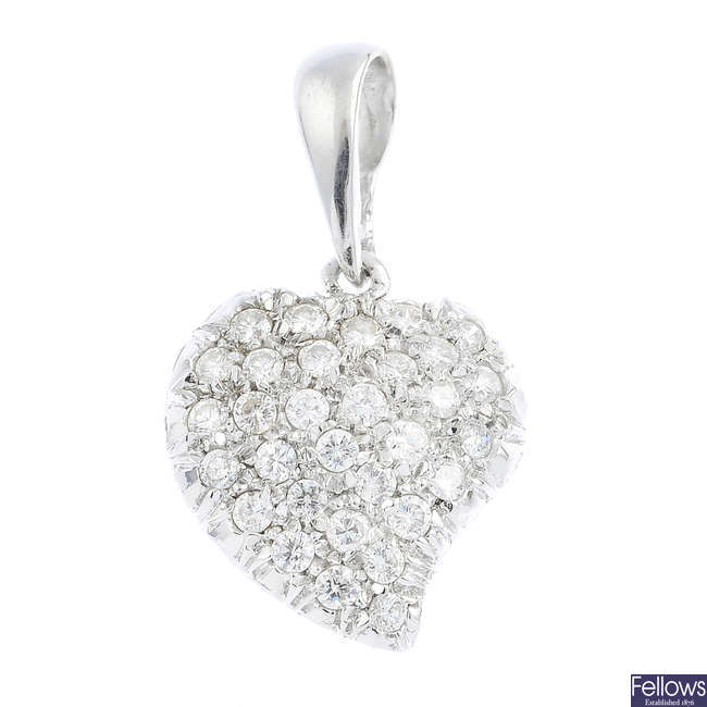 An 18ct gold diamond heart pendant.