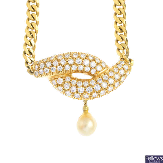 A diamond and pearl necklace.