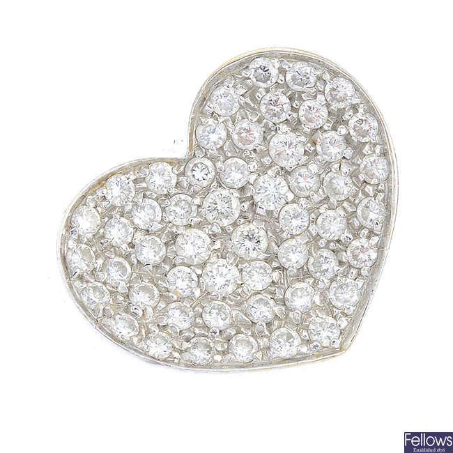 An 18ct gold diamond heart ring.
