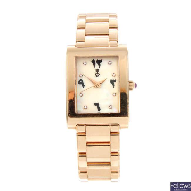 CORUM - a lady's 18ct yellow gold bracelet watch.