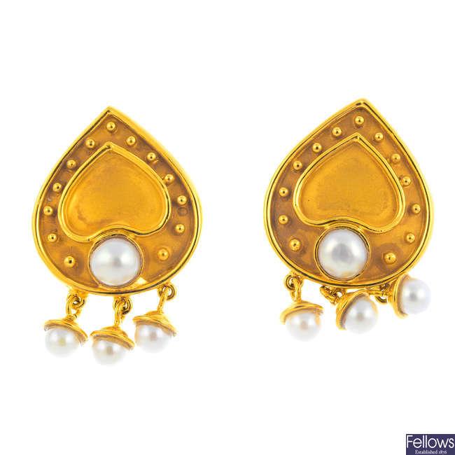 A pair of cultured pearl earrings.