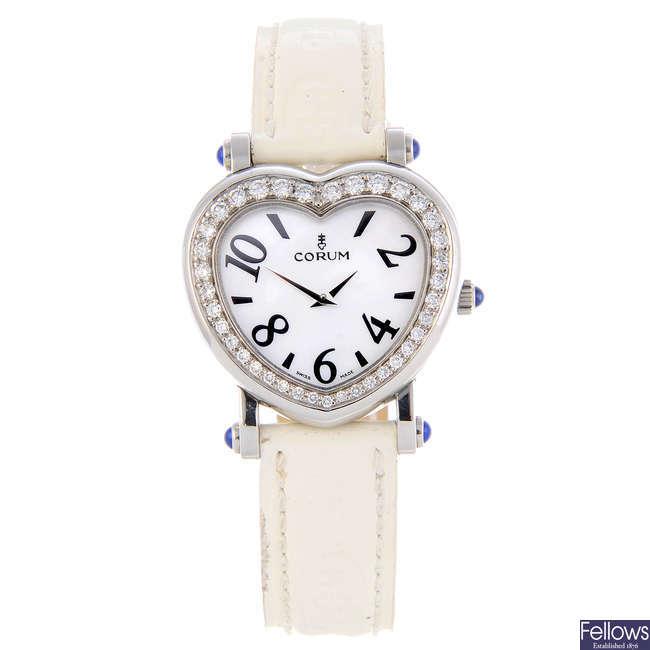 CORUM - a lady's stainless steel Heart Beat wrist watch.