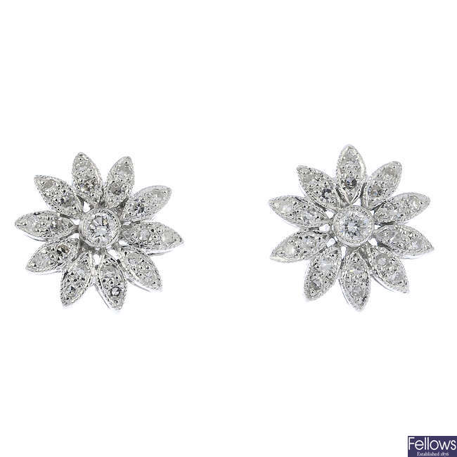 A pair of 18ct gold diamond floral earrings.