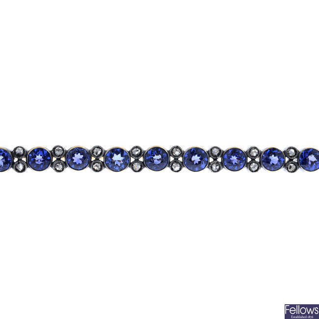 An early 20th century gold, no-heat sapphire and diamond bar brooch.