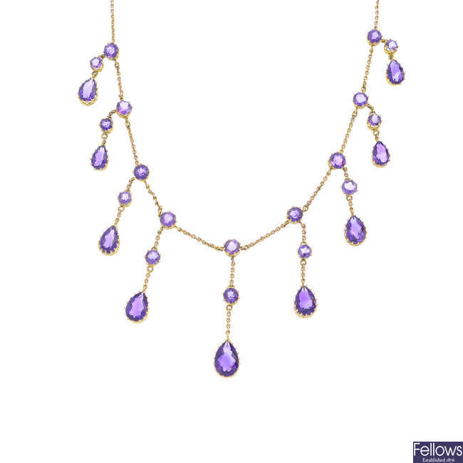 An early 20th century gold amethyst necklace.