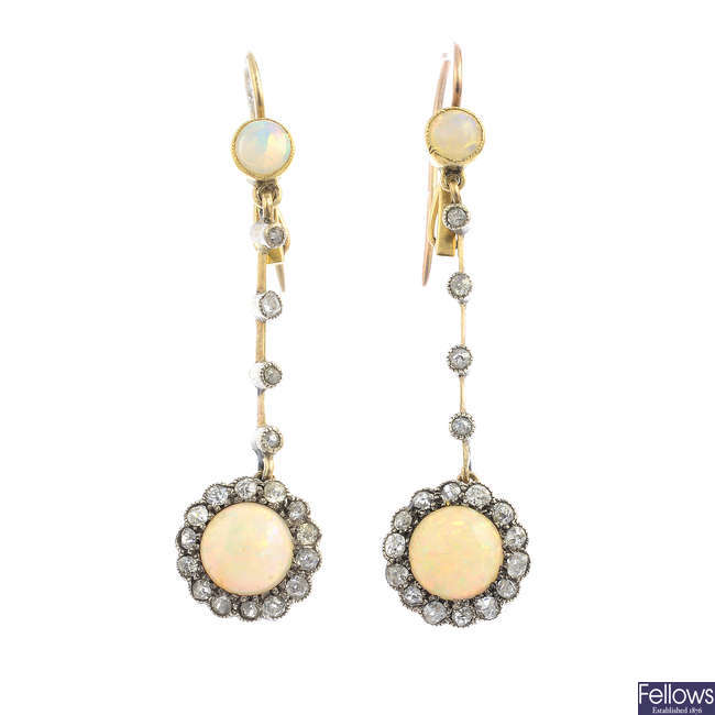 A pair of early 20th century gold opal and diamond earrings.