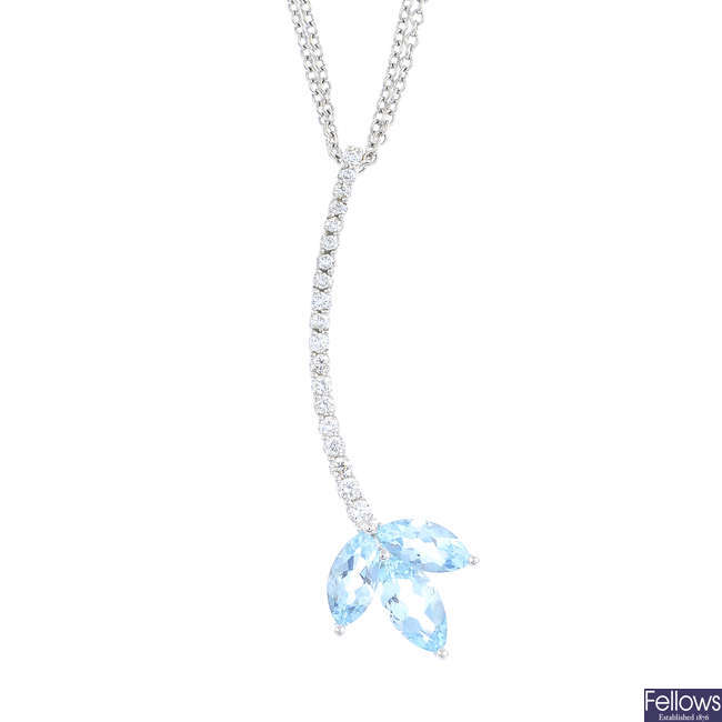 An 18ct gold aquamarine and diamond pendant, with chain, by David M Robinson.