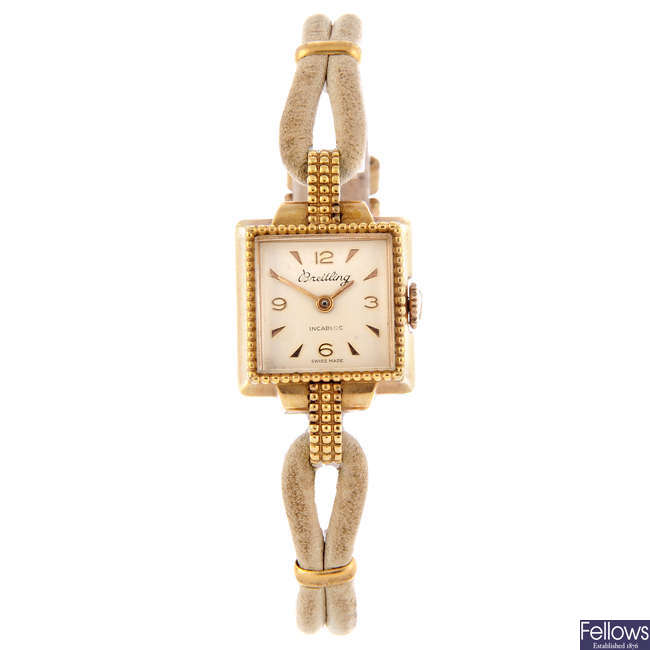 BREITLING - a lady's gold plated bracelet watch.