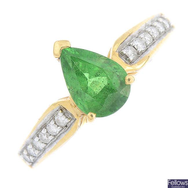 An 18ct gold tsavorite garnet and diamond ring.