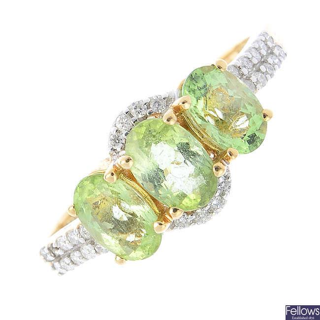 An 18ct gold, green tourmaline and diamond ring.