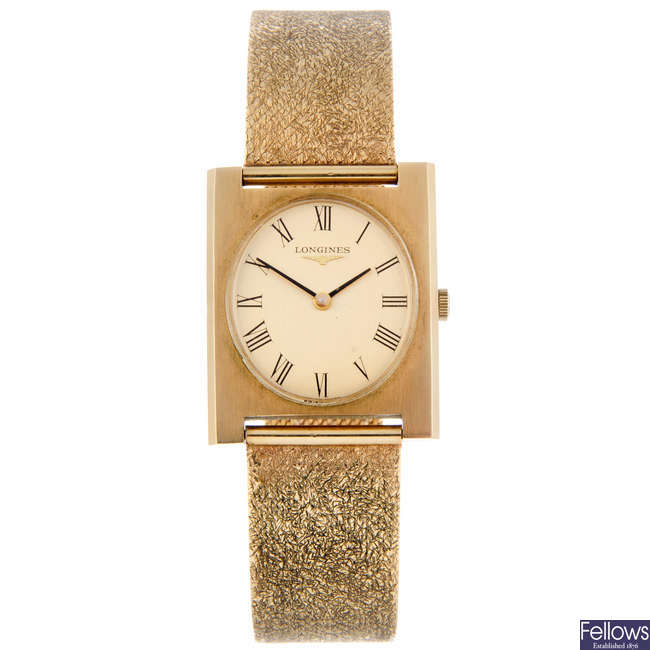 LONGINES - a gentleman's 9ct yellow gold bracelet watch.