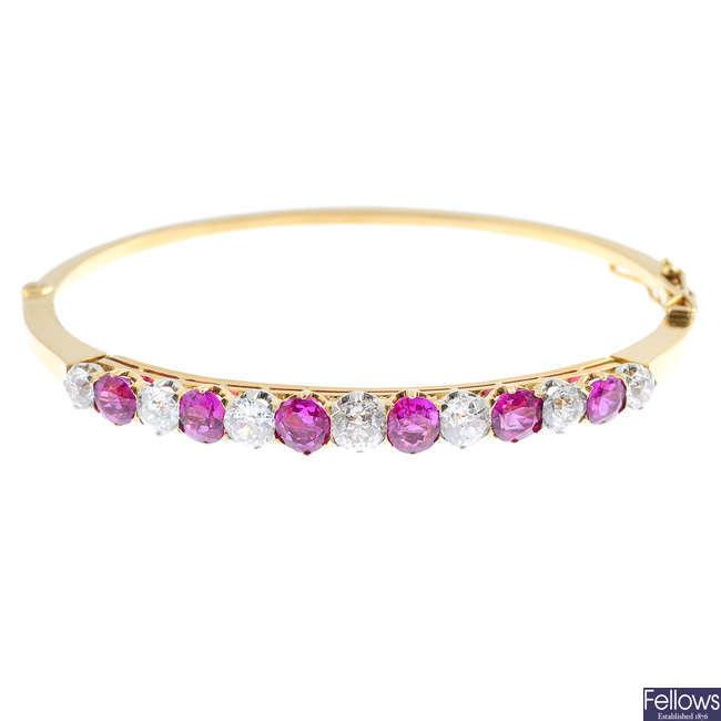 An Edwardian 18ct gold Burmese ruby and diamond bangle.