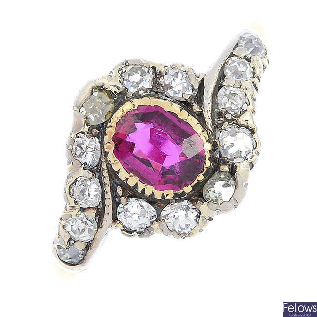 A late Victorian gold and silver ruby and diamond cluster ring.