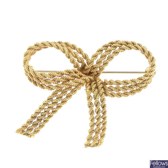 CARTIER - a mid 20th century bow brooch.