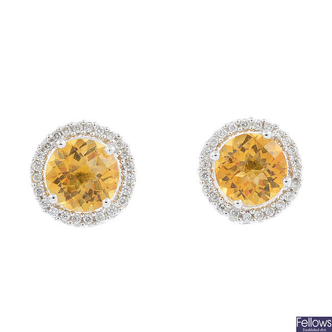 A pair of 18ct gold citrine and diamond cluster earrings.
