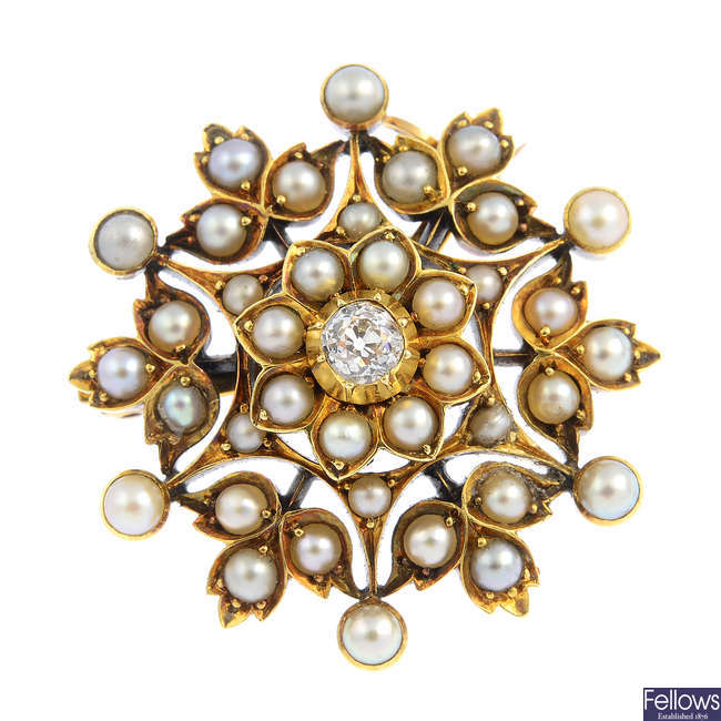 An early 20th century gold diamond and split pearl brooch.