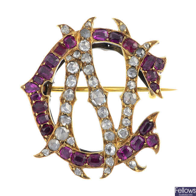 A late Victorian gold diamond and ruby monogram brooch.