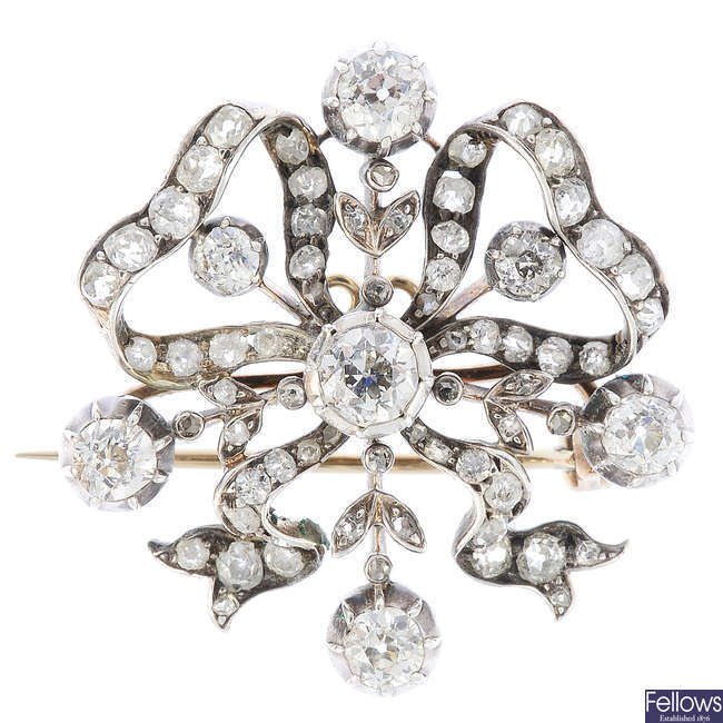 A late Victorian silver and gold diamond brooch.