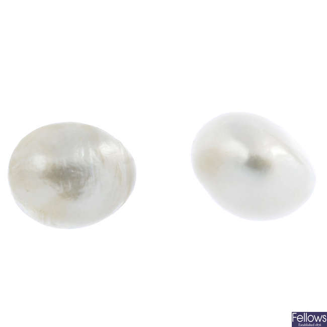 A pair of oval-shape natural pearl stud earrings.