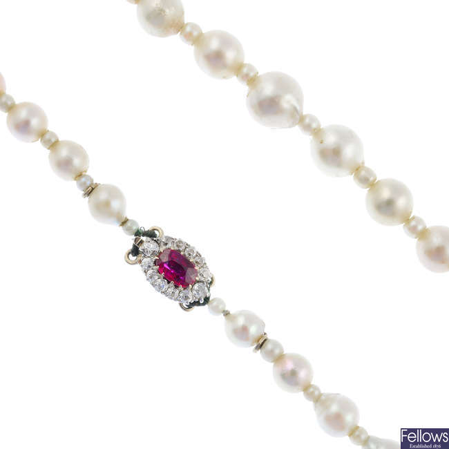 An early 20th century cultured pearl single-strand necklace, with ruby and diamond clasp.