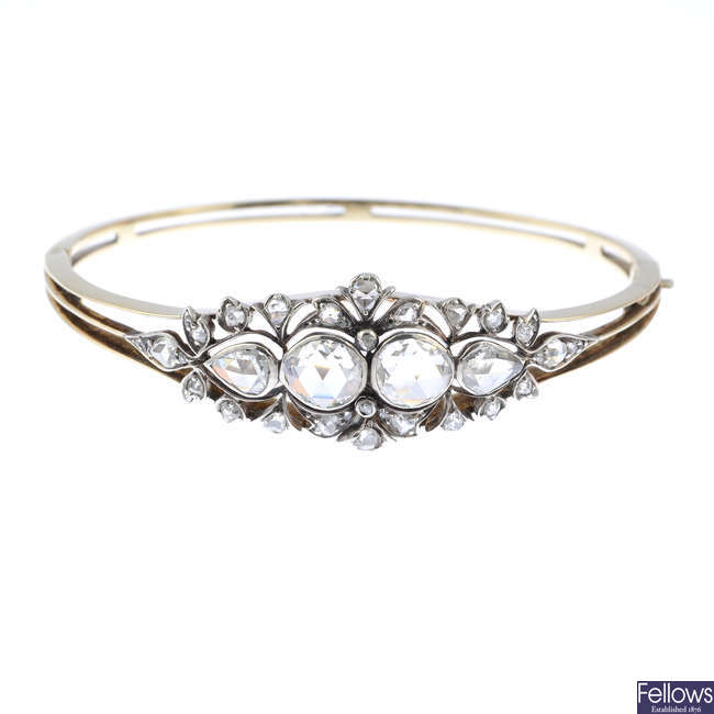 An Edwardian gold and silver, diamond hinged bangle.