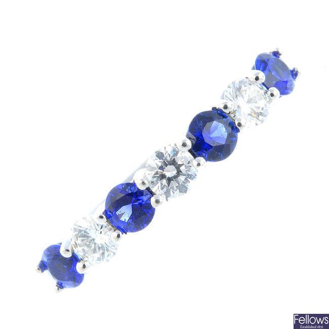 A platinum sapphire and diamond half eternity ring.