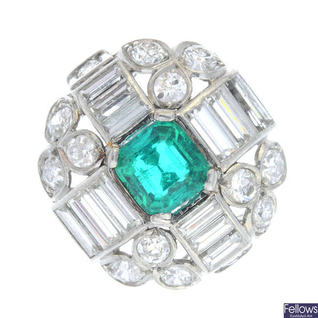 A mid 20th century platinum Colombian emerald and diamond dress ring.