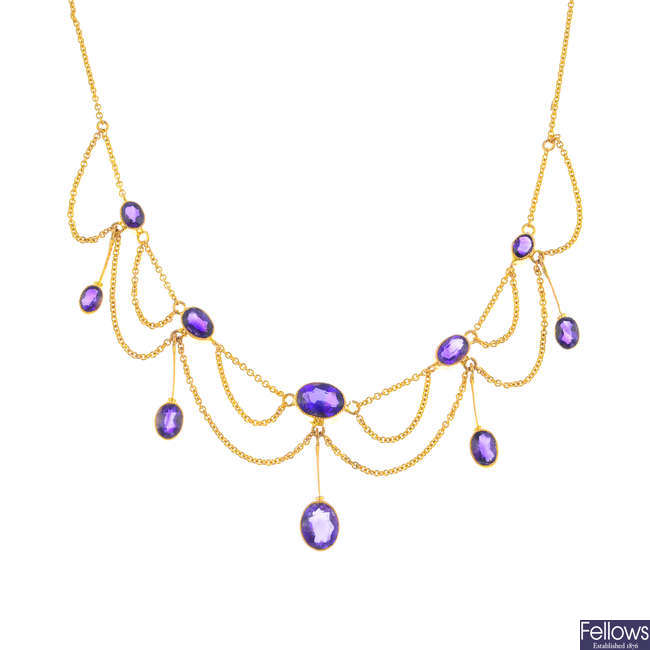 An Edwardian 9ct gold amethyst necklace.